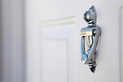 home security white front door